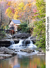Glade creek grist mill in autumn time with reflection
