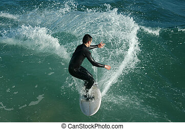 surfer - young catching waves