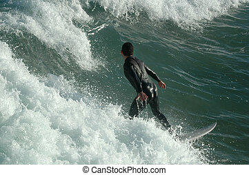 surfing - young catching waves