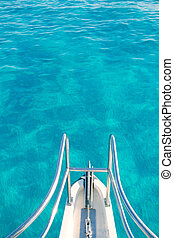 boat bow in transparent turquoise  water