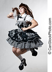 Cosplay girl in black dress jump up