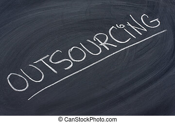 outsourcing word on blackboard - outsourcing word in white...