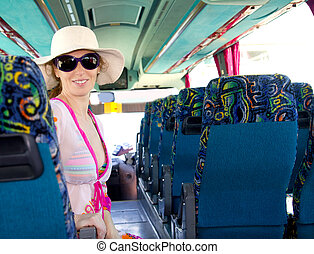 Girl on tourist bus happy with sunglasses in summer...
