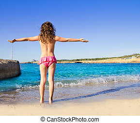 girl beach rear view in San Antonio of Ibiza Cala Conta