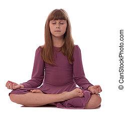 Girl on white background meditating - Girl sitting on floor...