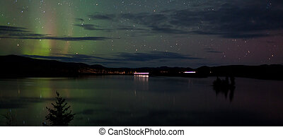 Stars and Northern Lights over dark Road at Lake - Night Sky...