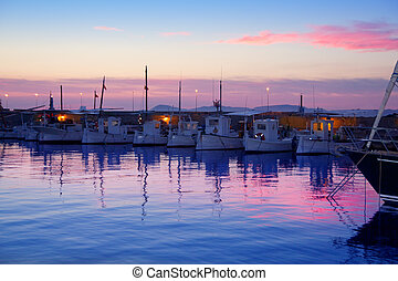 Formentera pink sunset in port marina of Mediterranean...