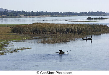 River Nile scenery with fishing boats - waterside scenery at...