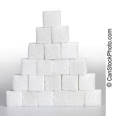lump sugar pyramid - Studio photography of a pyramid made of...