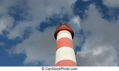 red and white lighhouse and sky
