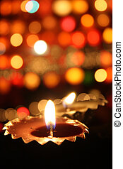 Festival of Light - Traditional lamp lit on the blur of...