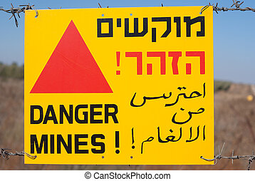 danger mines - a danger mines sign a the golan hieghts -...