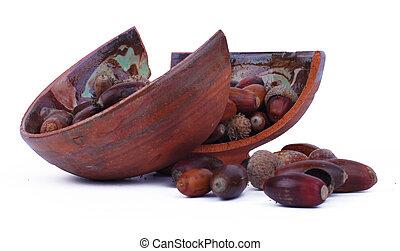 Broken pot full with acorns - Broken painted pot full with...