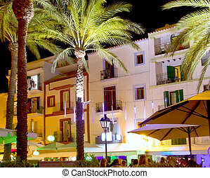 Ibiza island nightlife in Eivissa town white houses and palm...