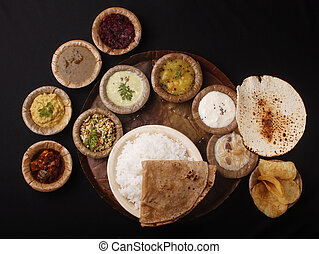 Indian lunch or meals - Indian lunch on stiched leaf plate...