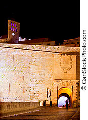 Ibiza castle night lights with fort main door and church