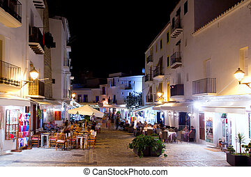 Ibiza dalt vila nightlife under night lights and white...