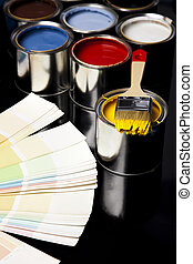 Paint and cans - Cans and paint on the colourful background