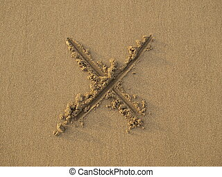 Cross sign drawn on sand - Sign of letter x drawn on wet...