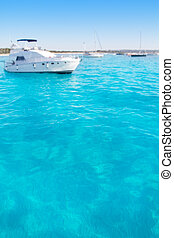 Anchored motorboats in Formentera Illetes beach near Ibiza