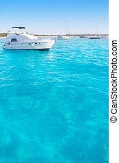 Anchored motorboats in Formentera Illetes beach near Ibiza