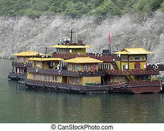 chinese house boats - colorful house boats on the Yangtze...