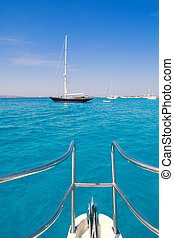 boat bow in Illetes Formentera Ibiza island with turquoise...