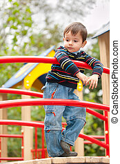 Thoughtful boy on the playground - Thoughtful boy is...