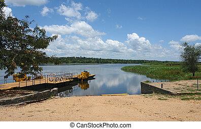 Nile scenery in Uganda - Nile scenery with ferry pier in...