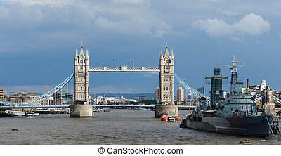 Tower Bridge and ship with Thames in London in front of...