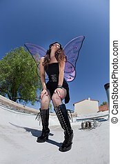Exhausted Fairy on Rooftop - Sexy Caucasian fairy stands...