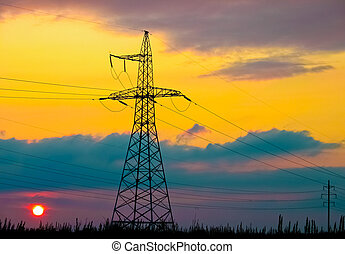 High voltage tower  on a background of the sunset
