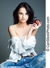 Sexy young woman with fresh red apple