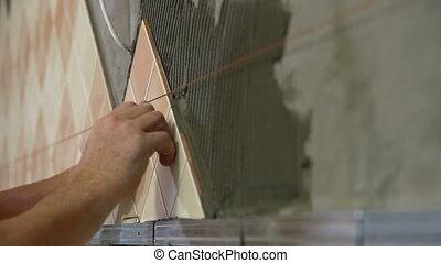 Worker installing Tiles