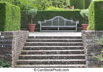 Wooden garden bench in English garden, Kent UK