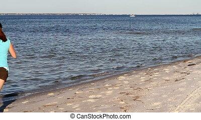Woman Jogging At Beach