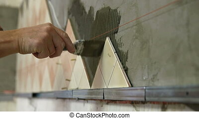 Installing Ceramic Tile - applying cement mortar with Putty...