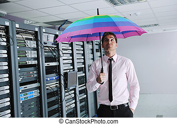businessman hold umbrella in server room - young handsome...