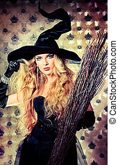 spooky - Charming halloween witch with broom over vintage...