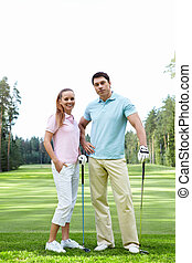 Golfing - The happy couple on the golf course