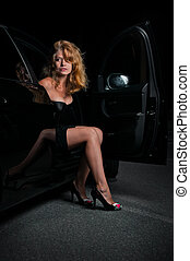 Beauty woman going out of car - Beauty woman going out of...