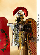 Roman armour in front of some shields
