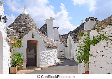 Typical trulli houses with conical roof in Alberobello,...