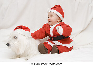 What a pair of Santas - A little baby with his pet dressed...