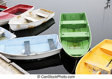 Colorful Old Boats - Overhead view of assorted old rowboats...