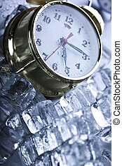 Alarm clock among ice cubes - The photography of classical...