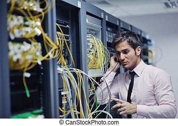 it engineer engineer talking by phone at network room -...
