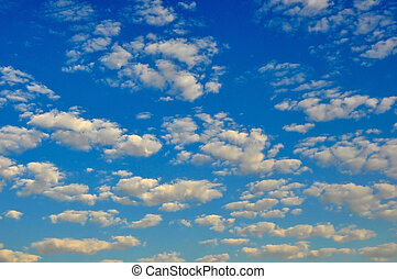 Blue Sky with Clouds - Blue sky with puffy white clouds
