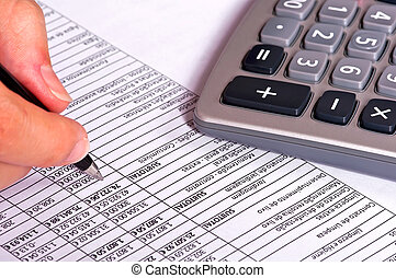 Doing Accounts - Businessperson doing accounts with a...