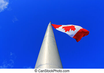 Canadian Flag - Canadian flag surrounded by blue sky.